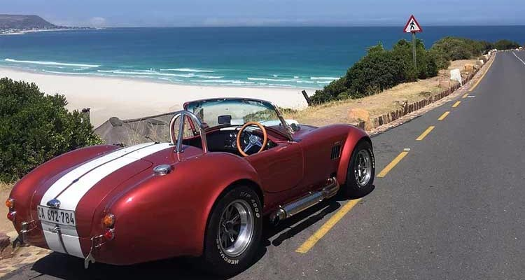 Zip around Chapman's Peak in a classic (open-top) sports car